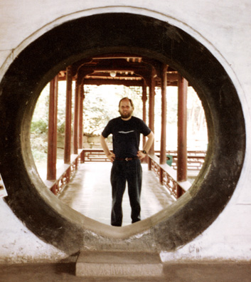 THREE SUS: Paul in a circular doorway.