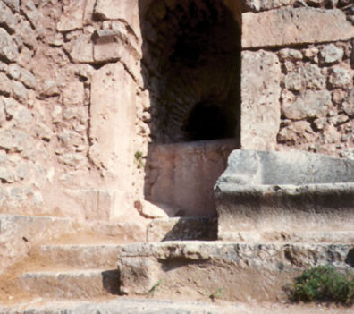 DELPHI: This rounded arch probably marks a Roman construction, since though the Greeks knew of such arches, they seldom used them.