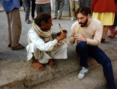 World Music professor Paul Smith and sidewealk flute vendor.