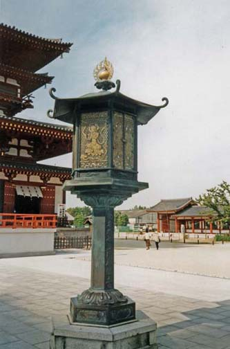 NARA: Replica of a lantern showing flute-playing spirits in front of an unidentified temple. The original is in a museum in Nara. May 21, 1998