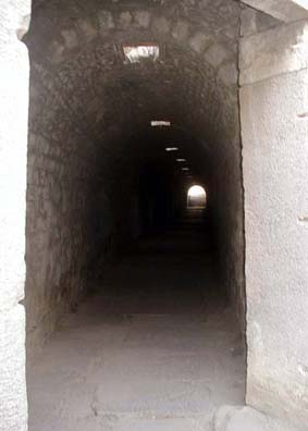 ASCLEPION: The corridor is a classic Roman vaulted tunnel...