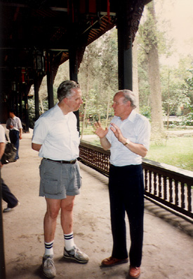 THREE SUS: Tom and Doug talking in the shrine.