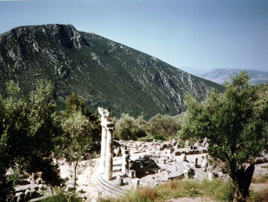 DELPHI: The Temenos of Athena includes the three reconstructed pillars of the Tholos, a round 4th-century building whose original function is unknown.