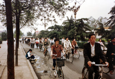 CHENG DU: At that time bicycle traffic was very heavy, with many elegantly dressed women pedaling along the streets as well as the men.