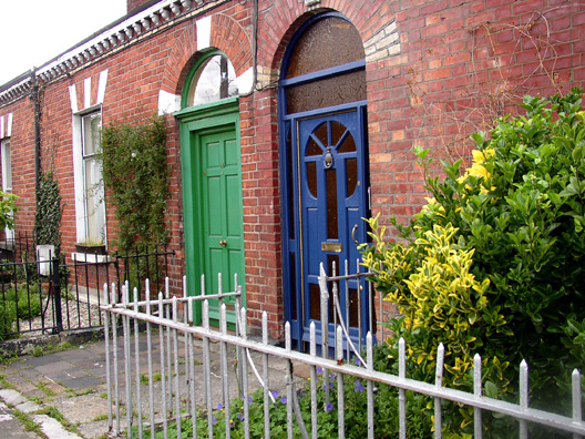 DUBLIN: The Joyce family, like the Dedalus family in Portrait of the Artist as a Young Man, had to move frequently to escape unpaid landlords. Behind the green door is 44 Fontenay St., the last house Joyce lived in with his family before leaving Ireland. The Irish love to paint their front doors with brilliant and varied colors (it's rare to see two alike next to each other).