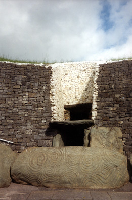 Brú na Bóinne: Although these clearly served as burial mounds, some of them like Newgrange obviously had other ceremonial uses. Above the entry door was found a shaft which admits a beam of light to illuminate the central chamber only at dawn on the winter solstice (if the weather happens to be clear--no sure thing!). Because of the precession of the equinoxes, the illumination is a little off in modern times, but the alignment is still quite close. The restoration of the facade around the entrance is controversial, having been created by archeologists making guesses based on rubble in the 1960s. It's striking, but seems implausible. Visitors are taken inside the central chamber, which is awe-inspiring (photography forbidden).