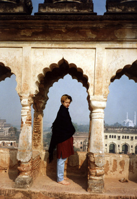Megan gives a sense of the scale of the arches. In the distance, the roofs of Lucknow.