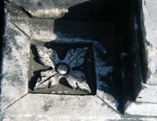 ASCLEPION: Floral decorations in various designs are scattered on marble fragments nearby.