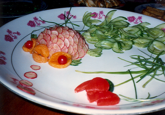. . . including this fish carved out of vegetables, blowing radish-slice bubbles.