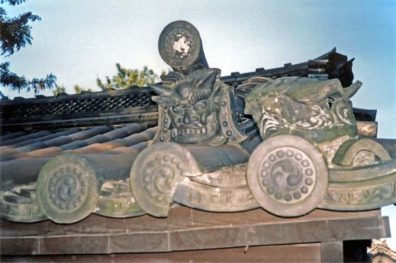 NARA: Nara is very proud of its architectural history. This recent house had traditional fierce-looking guardian spirit images on its roof. May 21, 1998