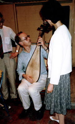 SZECHUAN MUSIC CONSERVATORY: Michael with pipa and erhu. (We had pipa's made of food floating in soup at dinner.)