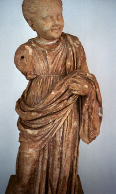 DELPHI: A terracotta decorative Hellenistic sculpture of a child.