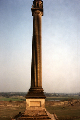 A gigantic classical column built for decorative purposes by wealthy eccentric Major General Claude Martin (d. 1800). To get a sense of its size, note the cattle grazing nearby on the left.