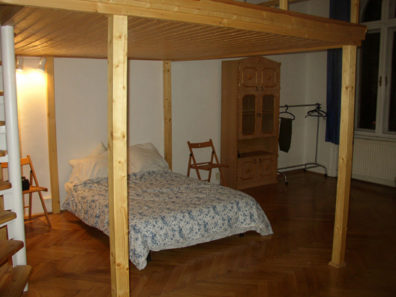 BUDAPEST:A bed in our apartment (loft with another bed above).