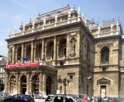 BUDAPEST: On our last night we attended the opera, paying less for third-balcony seats to Verdi's Otello than we were to pay a few days later in New York to go to a movie. Statues of famous composers stand along the top of the opera house.