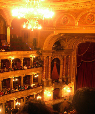 BUDAPEST: View from the cheap seats (some of the action was hidden from us down on stage left.) The interior was just as gorgeous as the opera house in Prague, but the production was far more lavish. Lighting, costumes, and sets reminded us of 19th-century paintings.