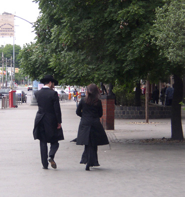 BUDAPEST: Couple in traditional Jewish dress on the Sabbath. Most Hungarian Jews were murdered by the Nazis in the waning months of World War II, but a small community and many foreign visitors sustain what is still the largest synagogue in Europe.