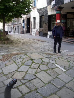 VIENNA: The artist's abhorrence of straight lines is reflected in the curving pavement outside and the comically wilting traffic barriers separating the sidewalk from the street (foreground).