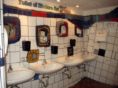 VIENNA: A restroom in the shopping center adjacent to Hundertwasserhaus, designed to match Hundertwasser's quirky architectural style.