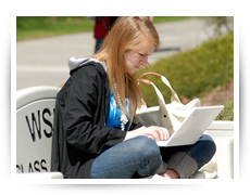 Photo of student with laptop