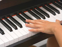 hand on piano keys
