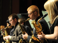 Students playing jazz saxophones