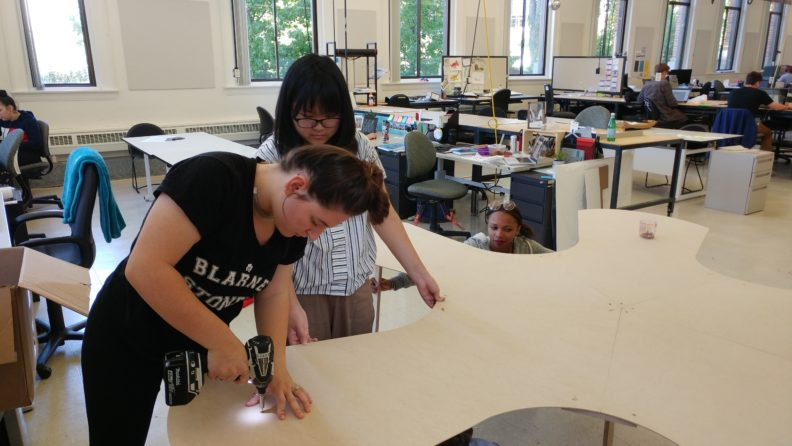 "Sarah Rosenthal and Kris Kha work on the ""Bench of Belonging"" prototype."