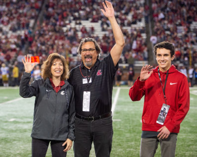Steve Austin is recognized by Provost Mitzi Montoya as the Featured Faculty member during the Cougars' game against UCLA.
