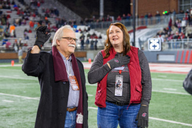 Interim provost Bryan Slinker and Julie Akers, clinical assistant professor in the College of Pharmacy, are appalauded by the crowd at Martin Stadium during the Cougars' victory over Oregon State on November 23.