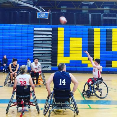 David Grassi shoots a basketball from his wheelchair.