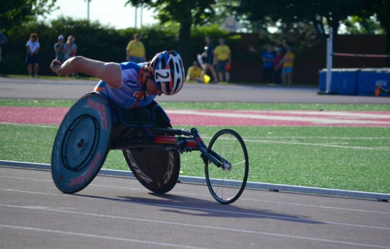 David Grassi races in his wheelchair on the track.