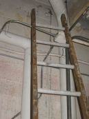 This ladder could damage pipe insulation and should be moved
