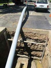 This concrete pipe being installed could contain asbestos