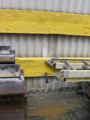 This asbestos cement siding is damaged and hazardous
