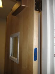 A metal plaque on its edge identifies this as a fire door
