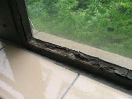 This deteriorated window putty should be reported