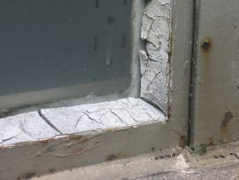 The panel adjoining this window could contain asbestos, also