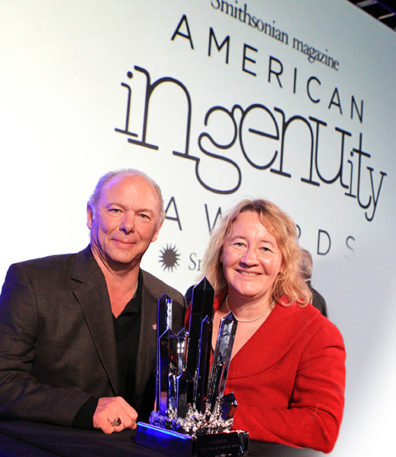 Physical Science award winner Dr. Michael Skinner, left, and Dr. Carol Greider with the award presented by Smithsonian Magazine during the 2nd American Ingenuity Awards Tuesday, Nov. 19, 2013 in Washington. Award winners include Dr. Adam Steltzner, technology; Dr. John Rogers, physical science; Dr. Caroline Hoxby, education; Dave Eggers and Mimi Lok, social progress; Dr. Caroline Winterer, historical scholarship; Doug Aitken, visual arts; Saumil Bandyopadhyay, youth; and St. Vincent, performing arts. (Sharon Farmer/sfphotoworks)