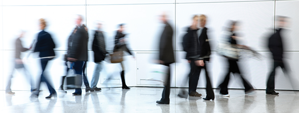 blurred people walking in hallway