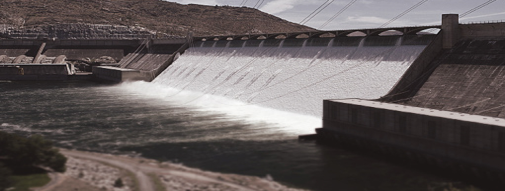 large dam with water coming through spillway