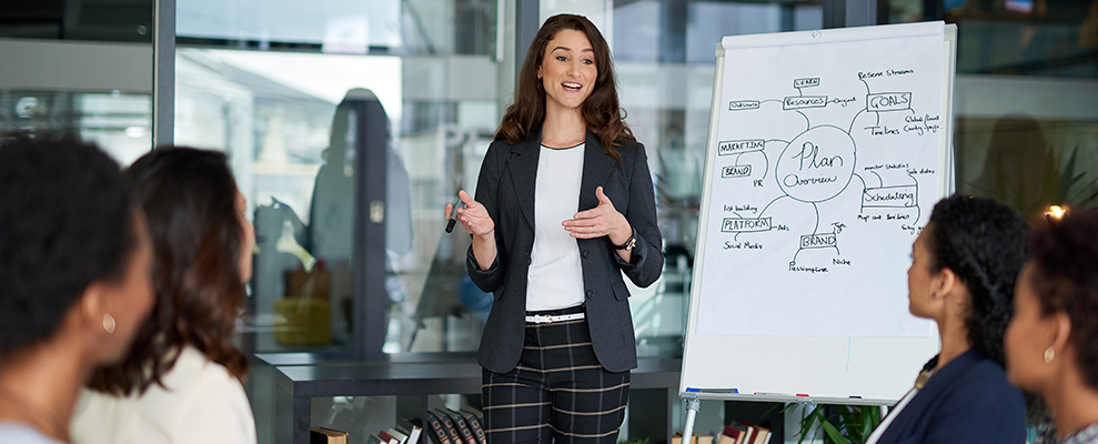 young businesswoman giving a presentation in the boardroom