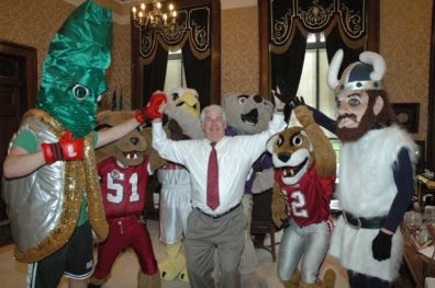 State Treasurer Mike Murphy rallies in his office with public higher education mascots.