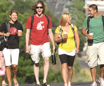 Students walking with drink cups