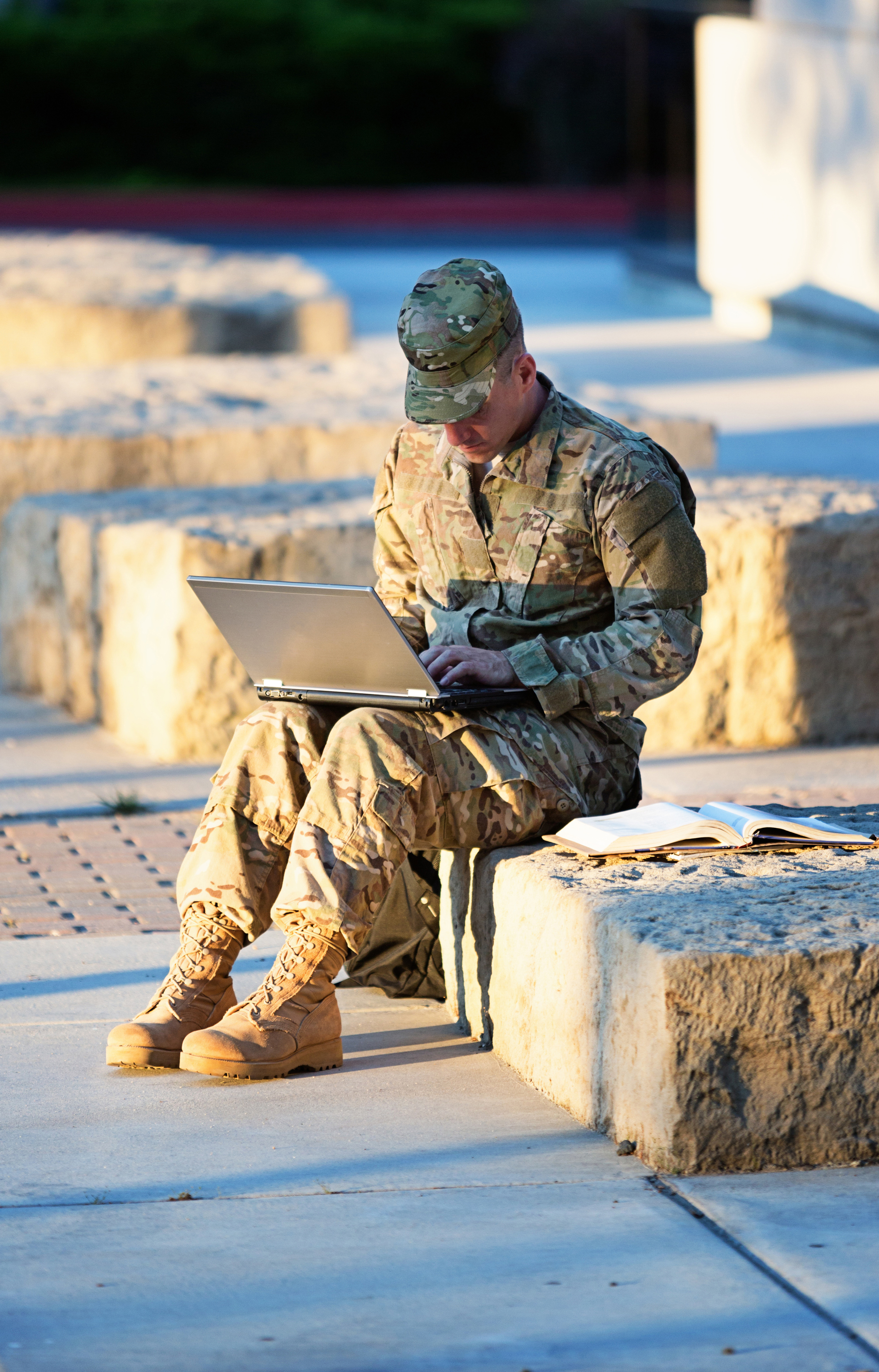Photo: Military Member Studying Online.