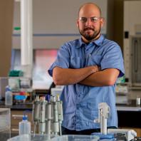 ARCS Scholar Nick Pokorynski posing in his lab
