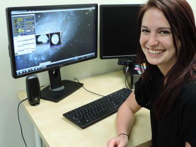 Grad Student Naomi Wallace looking at brain activity