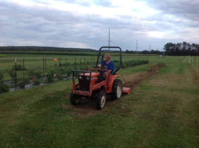 Graduate student Brent Arnoldusssen on a tractor