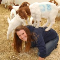 Student Rachel Bone with baby goats