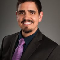 Graduate student Joel Velasco portrait with purple tie