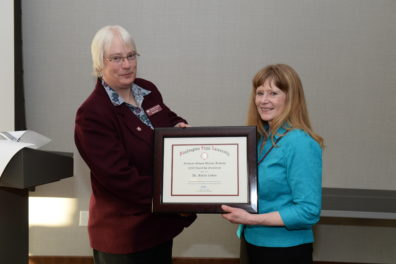 Interim Deal Lisa Gloss presents an award to Dr. Martha Cottam